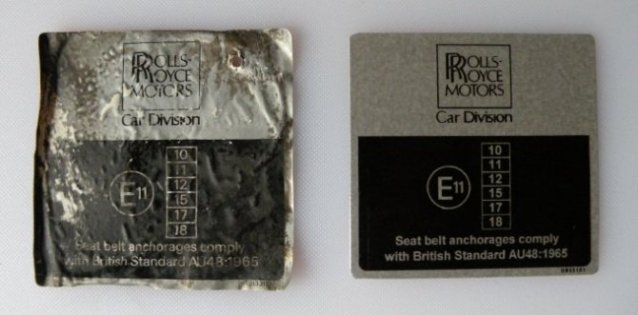 Seat belt compliance label old and new